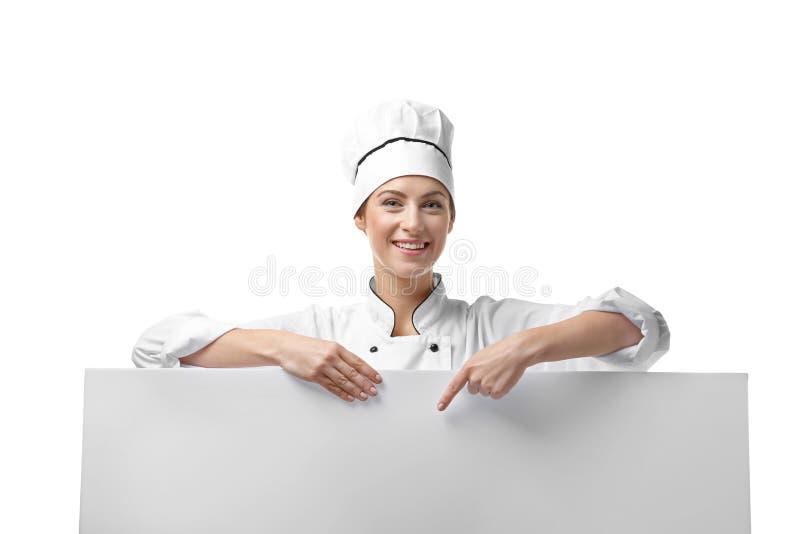 女性厨师画象有海报的在白色 库存图片