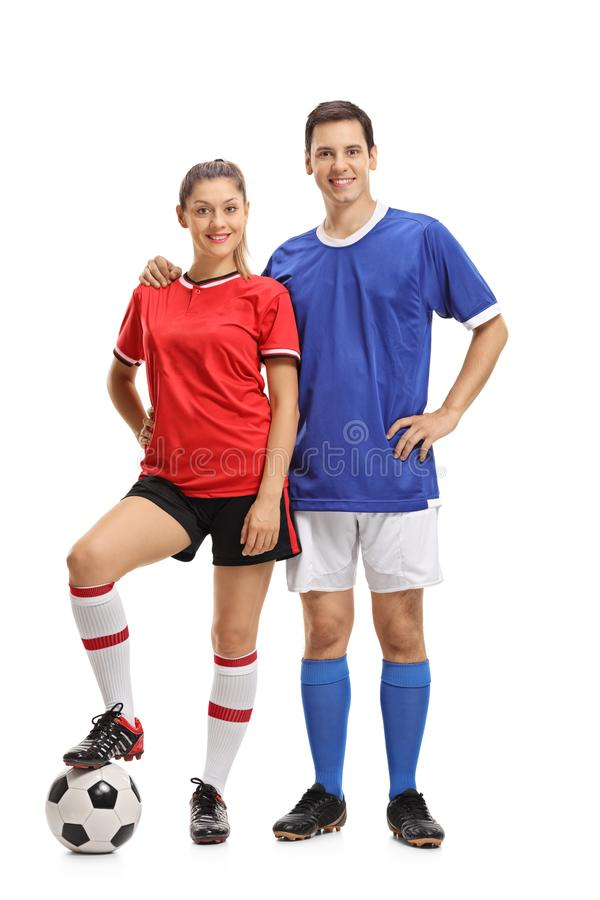女性和一个男性足球运动员 库存图片