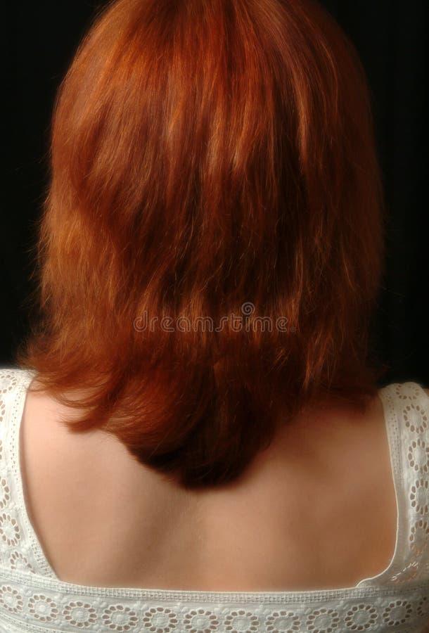 女性头发的红色 免版税库存图片
