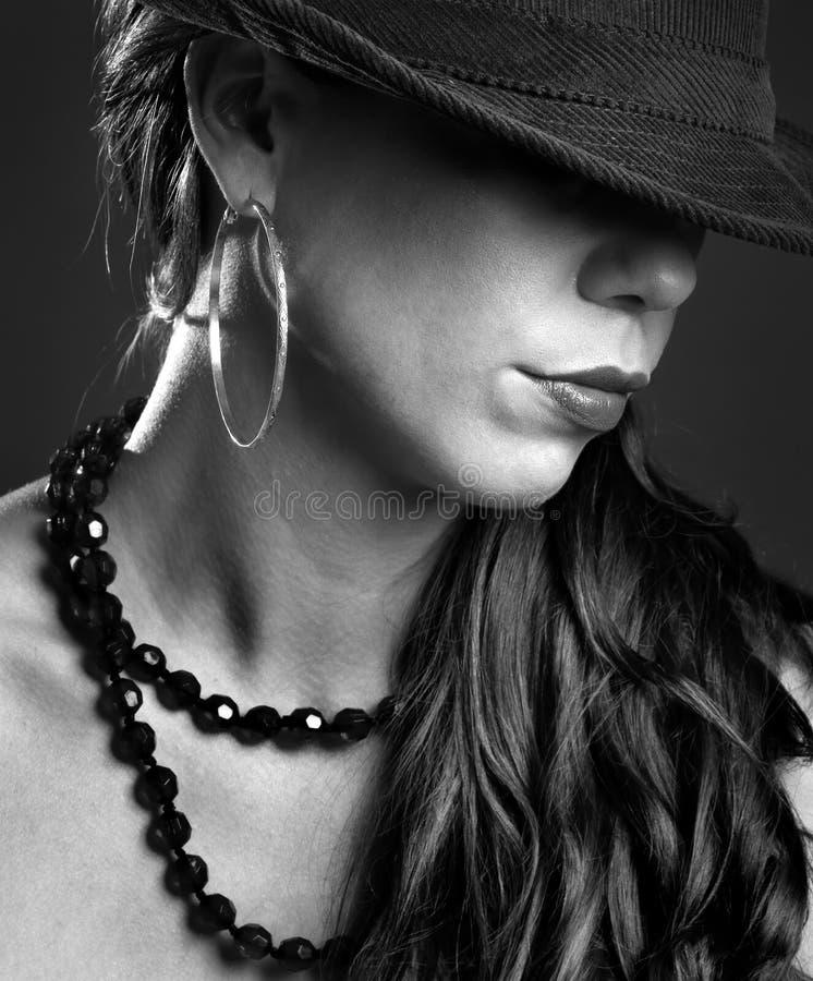 女性帽子奥秘 免版税库存图片