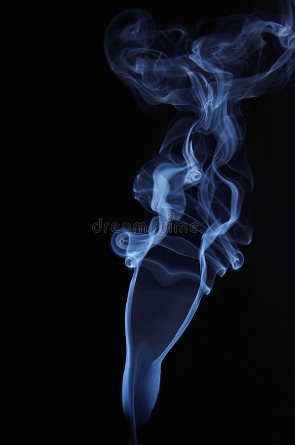 女性形状由抽烟的发烟制成 库存图片