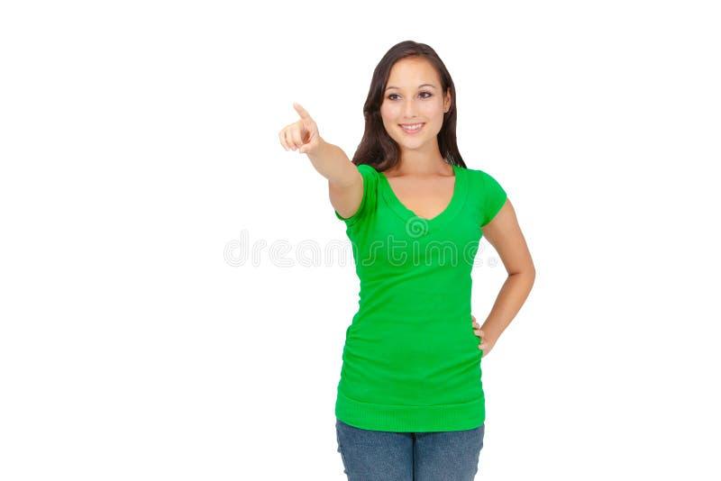年轻女性指向用手往 免版税库存照片