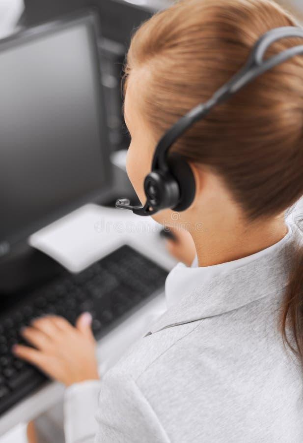 女性热线服务电话操作员 免版税库存照片