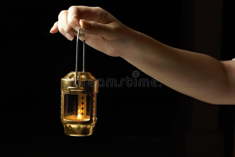 女性现有量藏品灯笼 免版税图库摄影