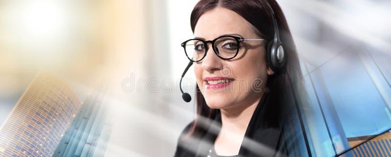 女性电话操作员画象有耳机的;多重曝光 免版税库存图片