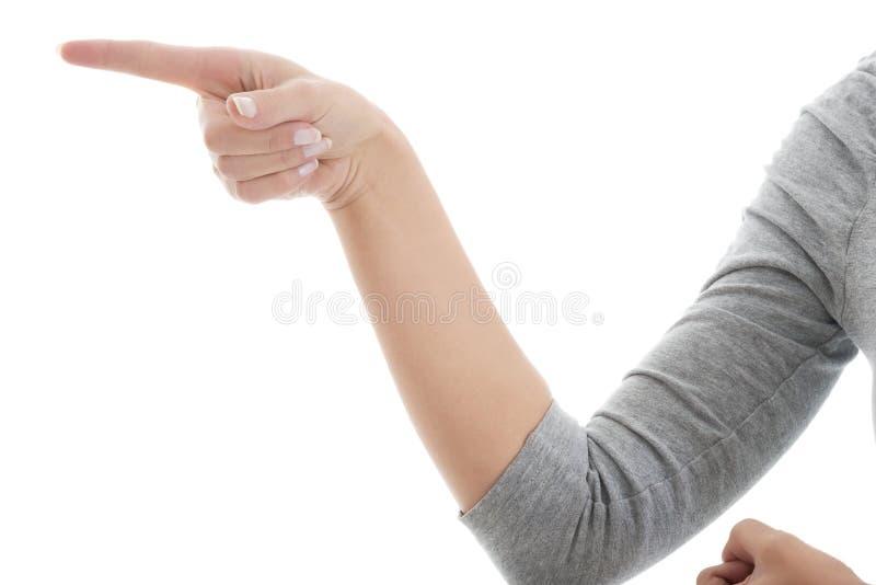 女性的手和指向手指。 免版税库存图片