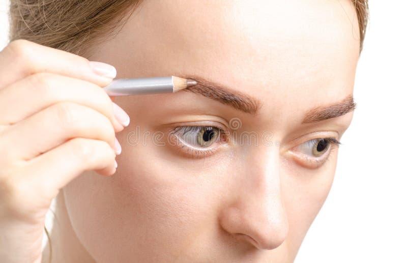 女性眼眉形状褐色眼睛眉笔 免版税库存图片