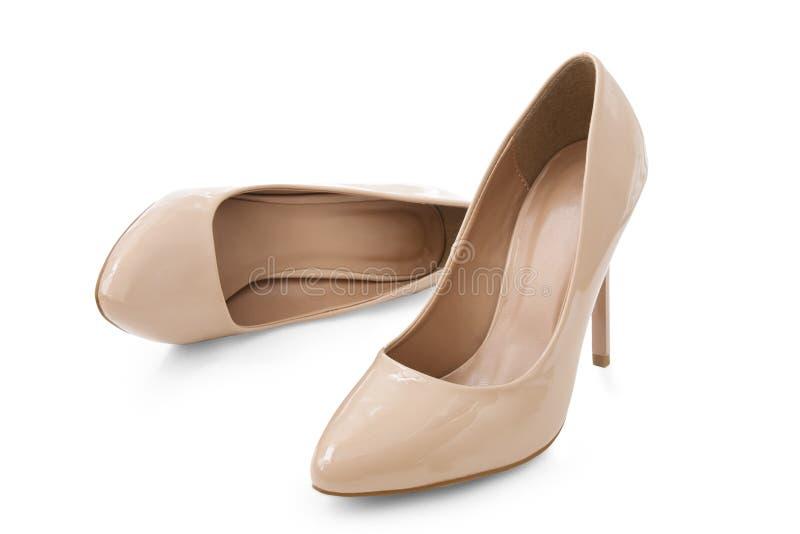 女性穿上鞋子米黄颜色 图库摄影