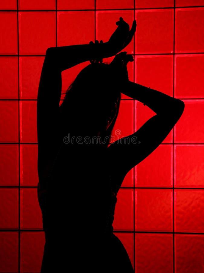女性红色剪影 免版税库存照片