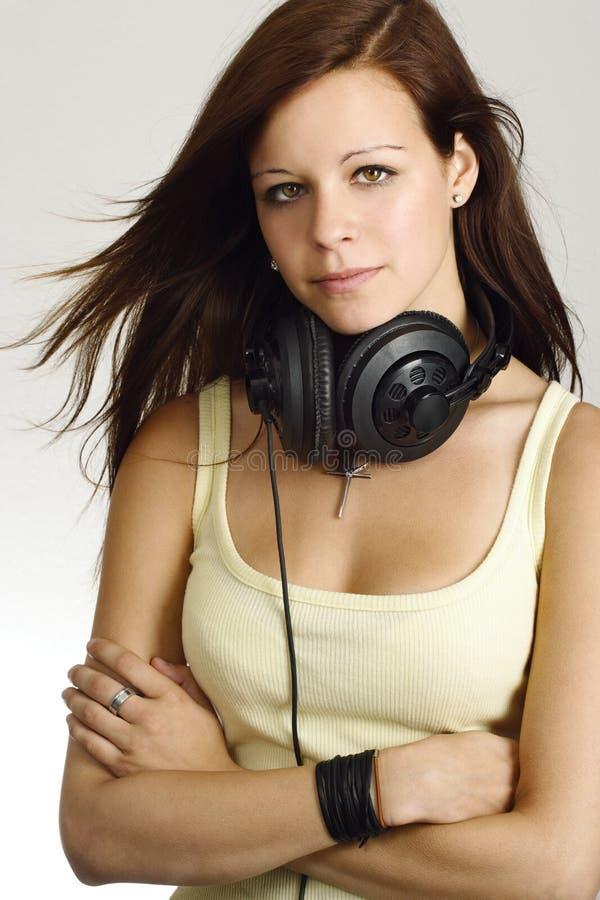 女性耳机少年 免版税库存照片