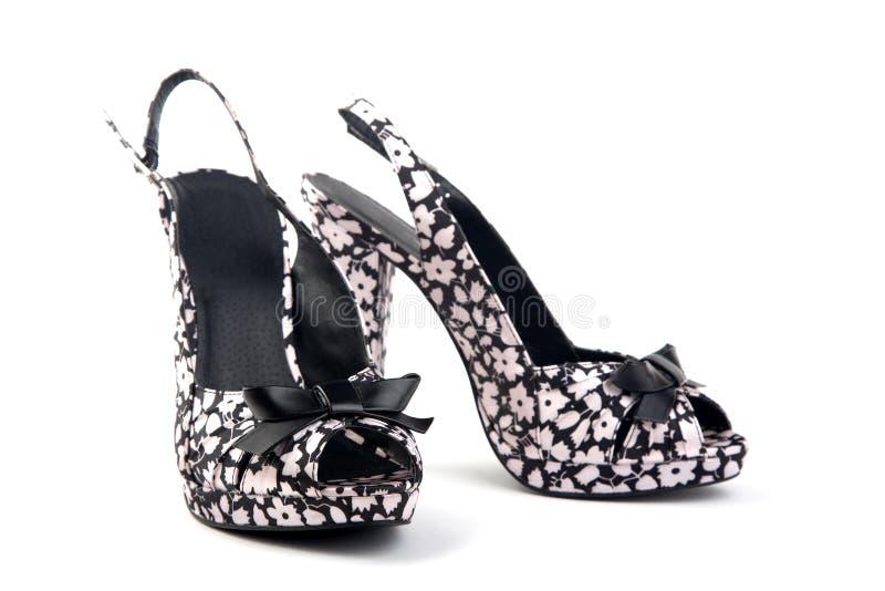 女性脚跟高对鞋子 免版税库存照片