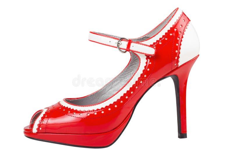 女性脚跟高查出的红色鞋子 免版税库存图片