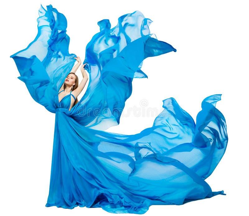 女性蓝裙波动,挥舞着丝布,白色面料的艺术时装模特 免版税库存照片