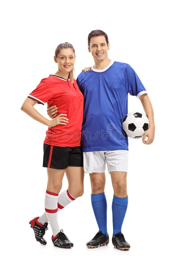 女性足球运动员和一位男性足球运动员 库存照片