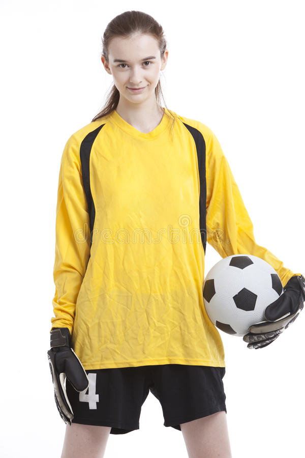 年轻女性足球运动员画象有球的反对白色背景 库存图片