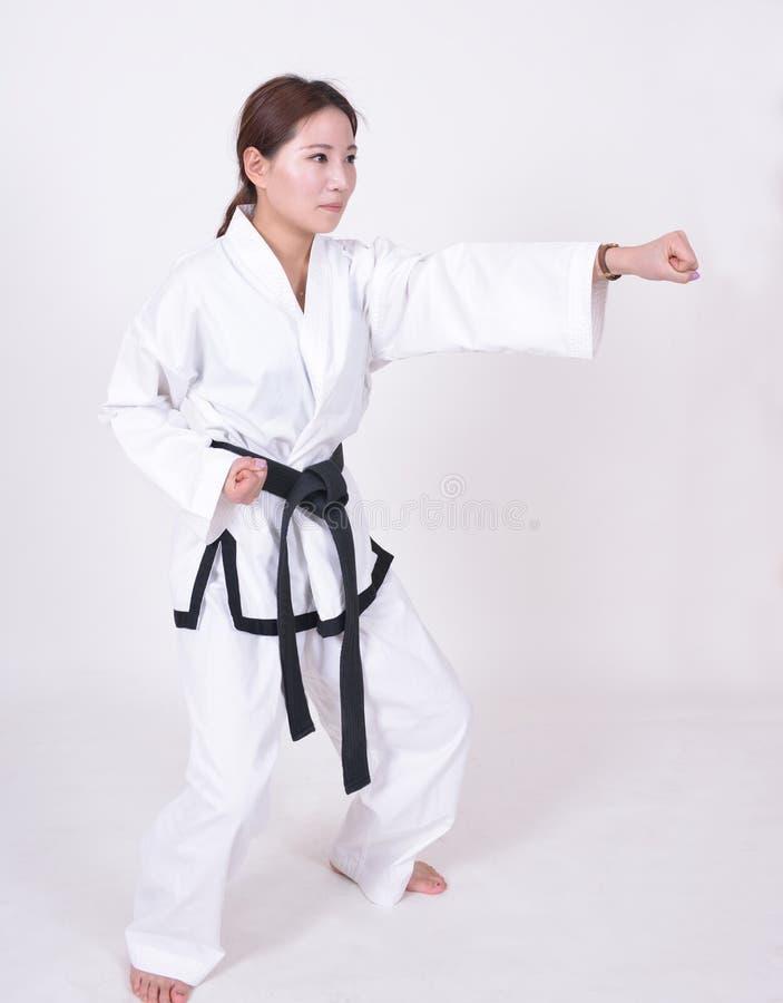 女性跆拳道运动员 免版税库存照片