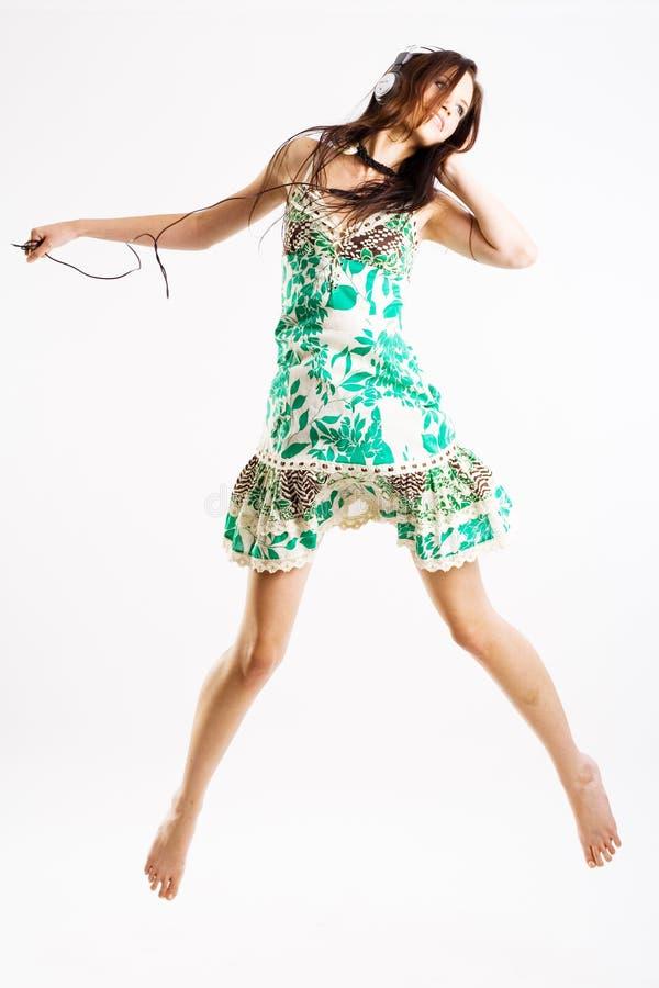 女性跳的年轻人 库存照片