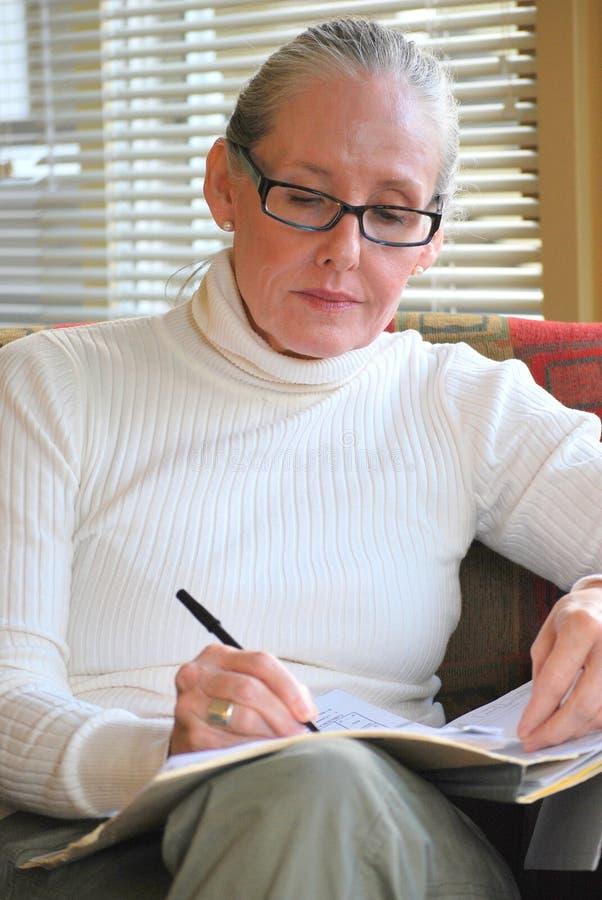 女性顾问在工作 免版税库存照片