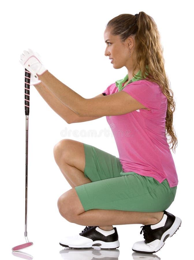 女性高尔夫球运动员 免版税图库摄影