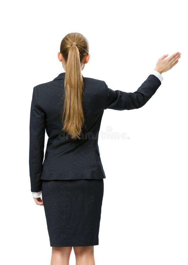 女性经理挥动的手Backview  免版税库存图片