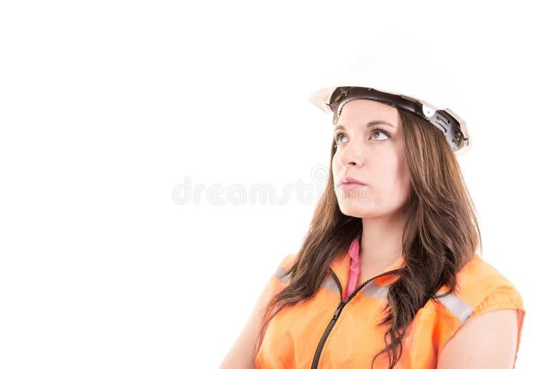 女性建筑工人或工程师有艰苦的 免版税库存照片