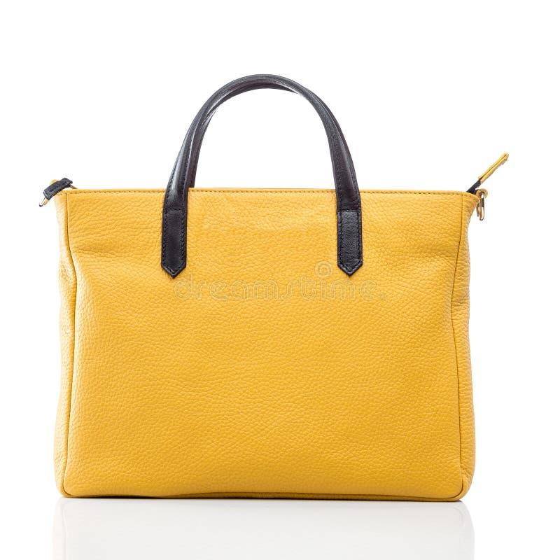 女性黄色皮革提包 免版税库存图片