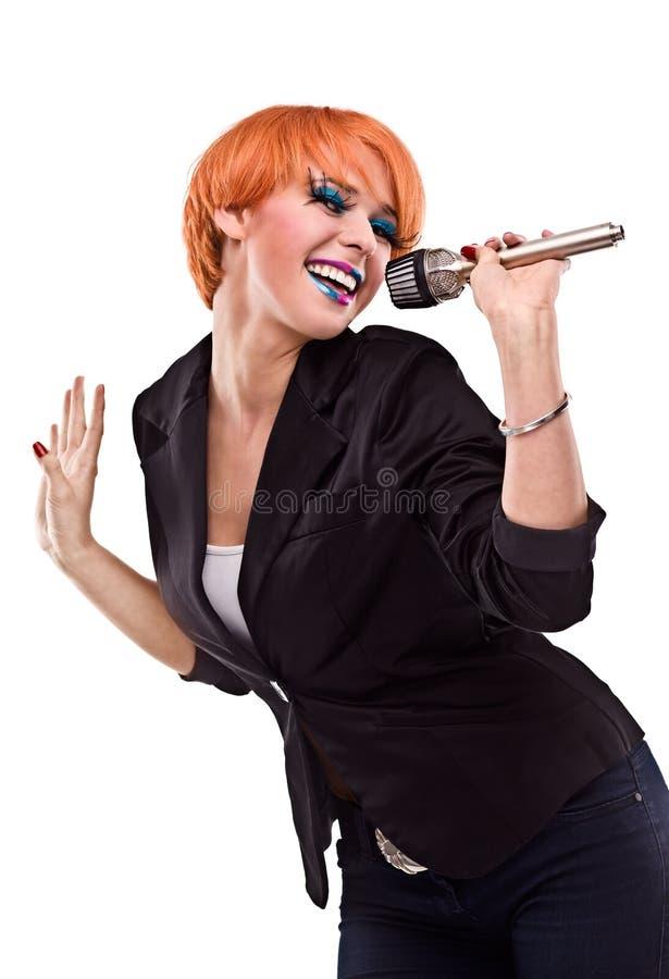 女性mic唱歌 库存照片