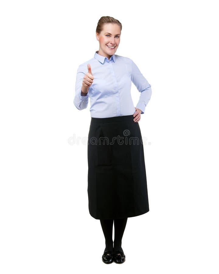 女服务员隔绝了显示好标志的onver白色背景,白肤金发 图库摄影