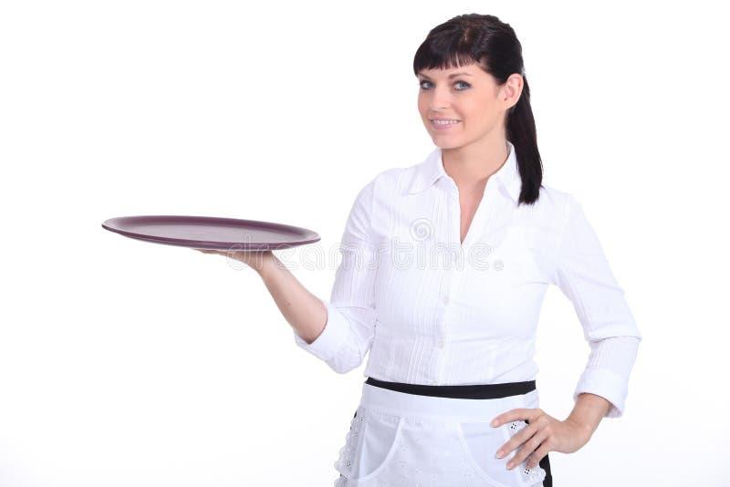 年轻女服务员 免版税库存图片