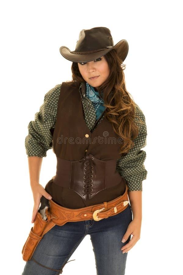 女牛仔用在枪的枪和手枪皮套手 免版税库存照片