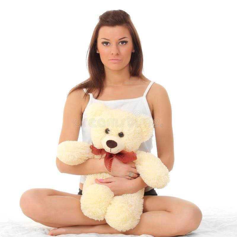 女用贴身内衣裤的女孩有玩具熊的 库存照片