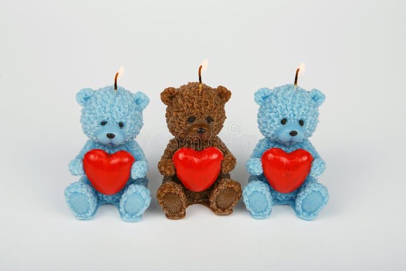 以女用连杉衬裤熊的形式滑稽的纪念品礼物蜡烛 库存照片