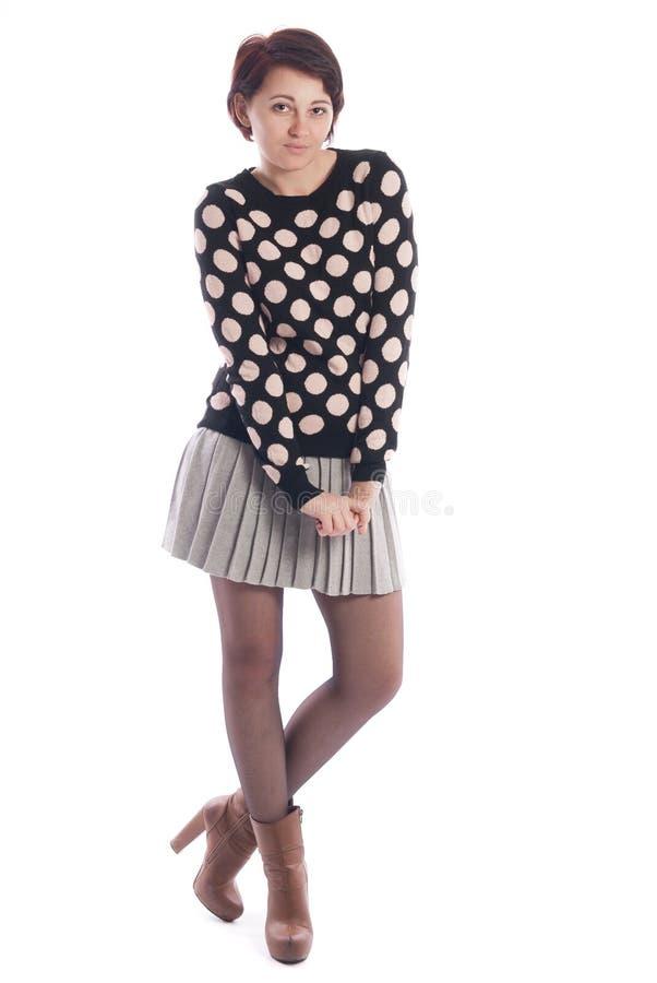 女衬衫和裙子的美丽的女孩 免版税库存图片