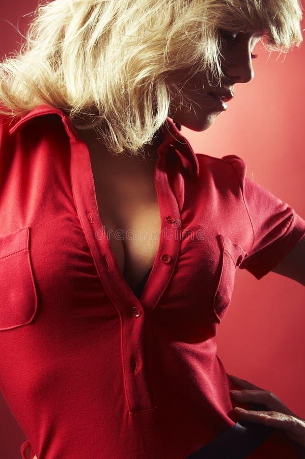 女衬衫女孩红色性感 库存图片