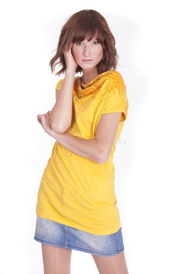 女衬衫妇女黄色 免版税库存照片