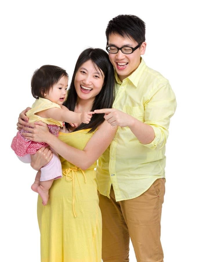 女婴有父亲的接触手指 库存照片
