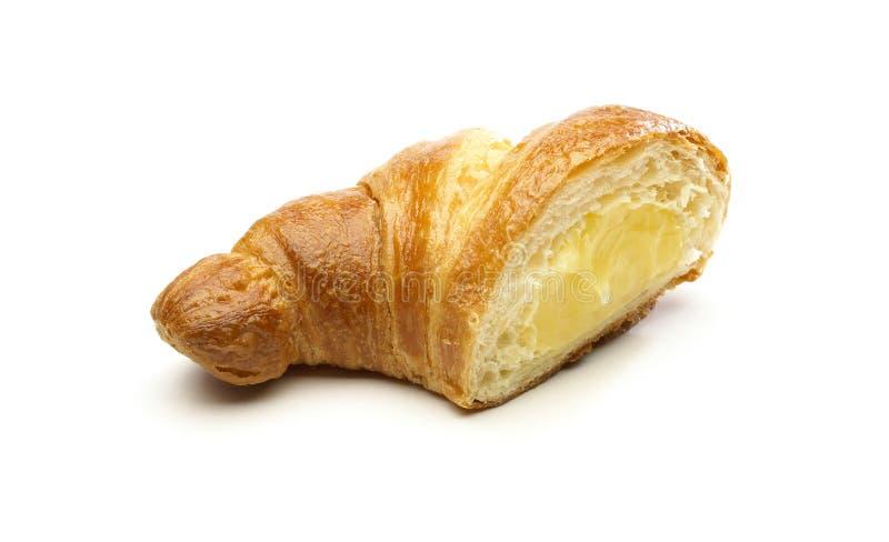 奶油色新月形面包已分解 免版税库存图片