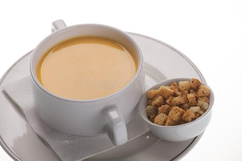 奶油色汤用薄脆饼干 免版税库存图片