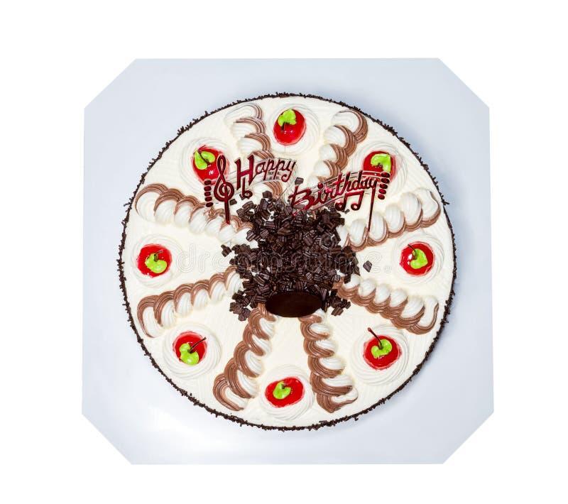 奶油色蛋糕用在白色背景隔绝的红色樱桃,截去 图库摄影