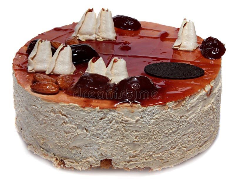 奶油色蛋糕用焦糖、坚果和干果子 免版税图库摄影