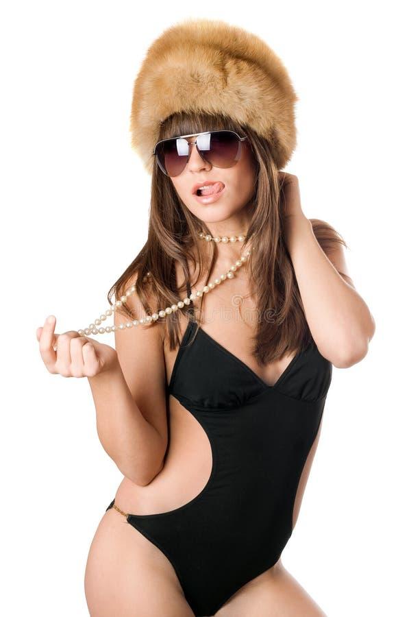 她显示的太阳镜舌头妇女 库存图片