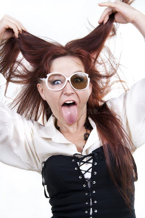 她的伸出的舌头妇女 图库摄影
