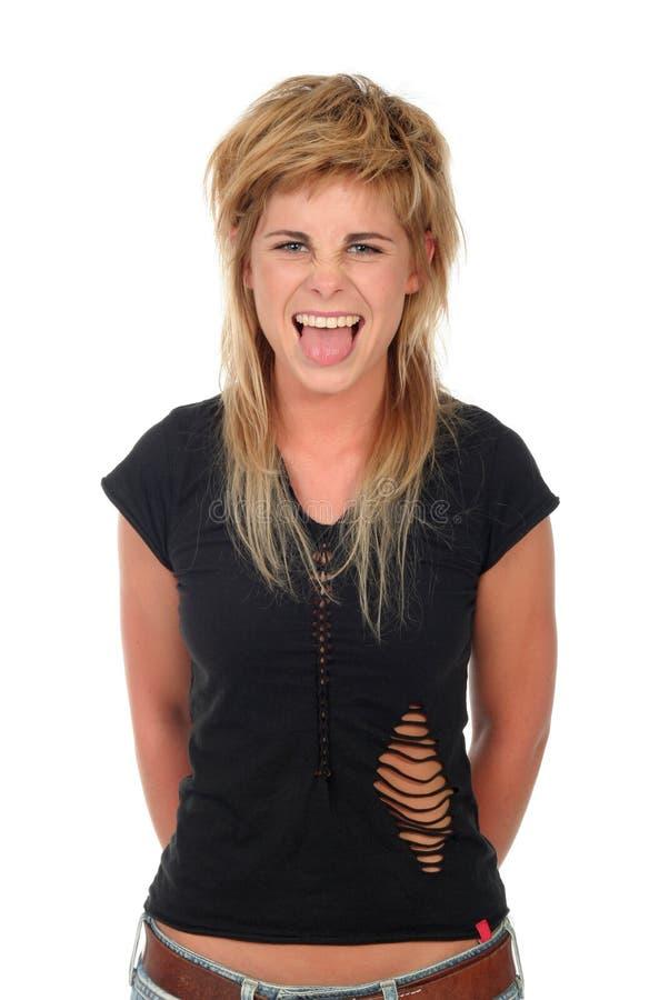 她的伸出的舌头妇女 免版税库存图片