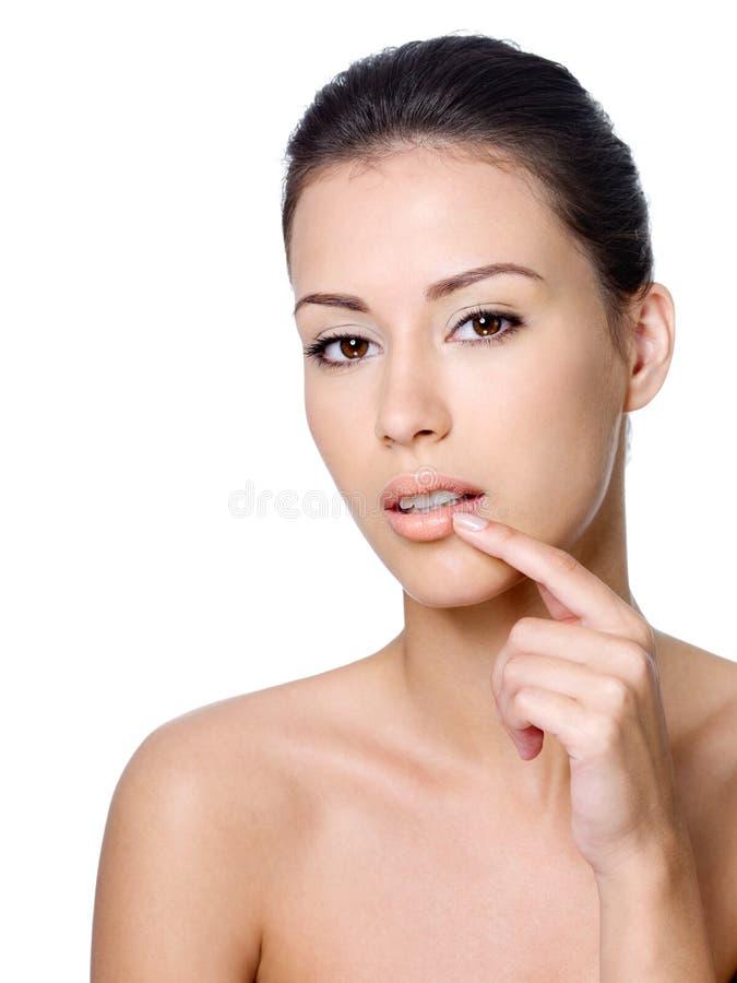 她的涉及妇女的嘴唇 图库摄影