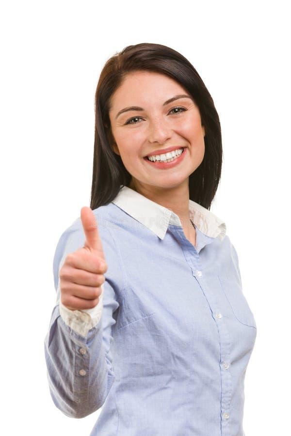 好姿态的年轻微笑的女商人 免版税库存图片