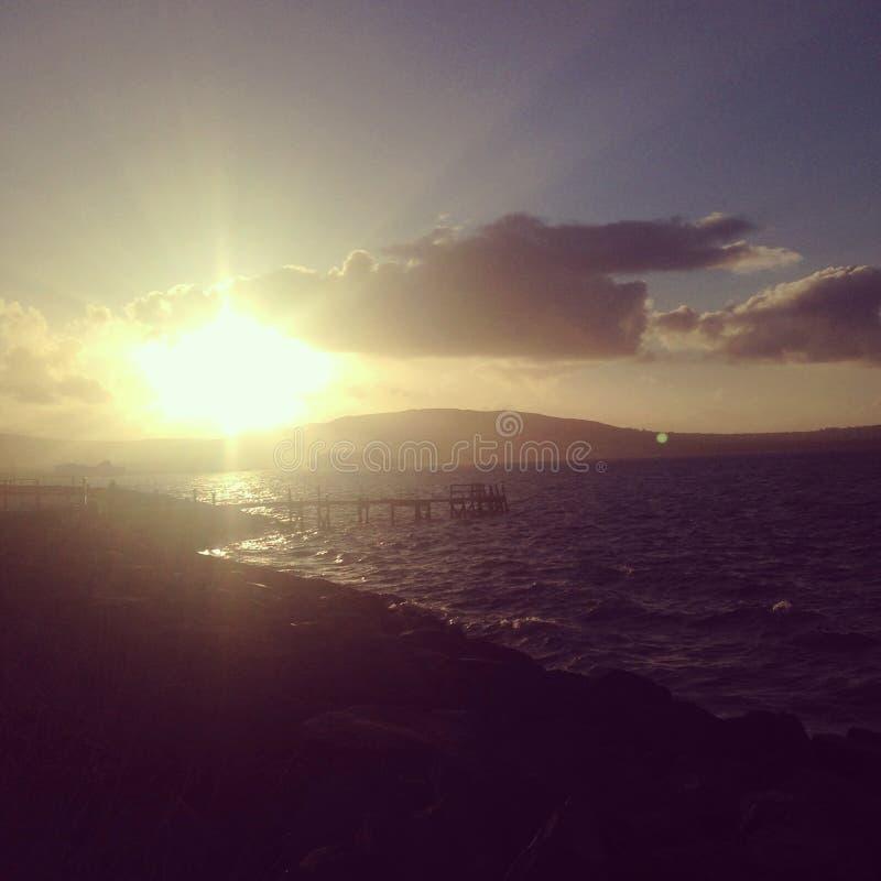 好莱坞海岸日落,北爱尔兰 库存图片