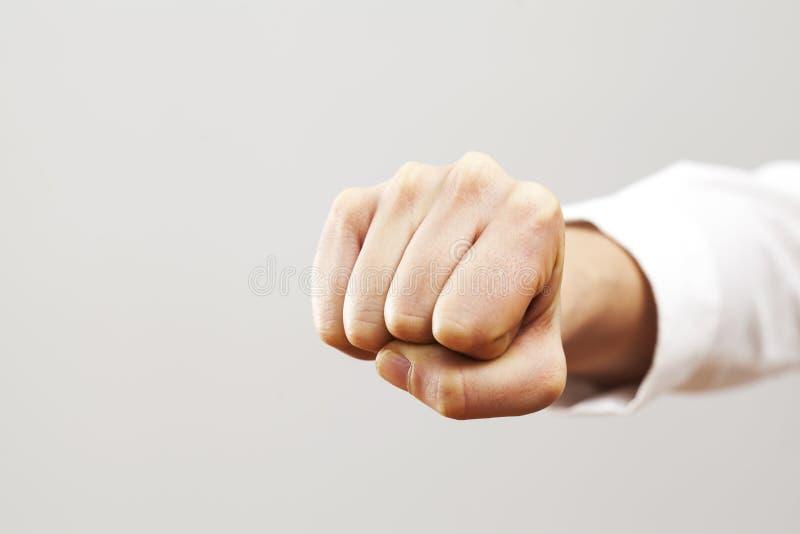 妇女与拳头的手势 库存照片