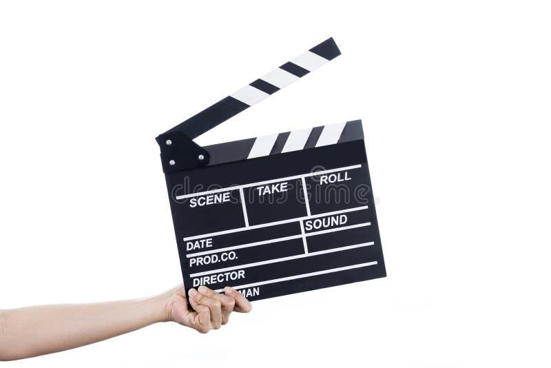 妇女举行在被隔绝的和白色背景的电影拍板 库存照片