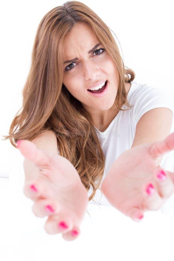妇女乞求为帮助用被伸的手  免版税库存照片