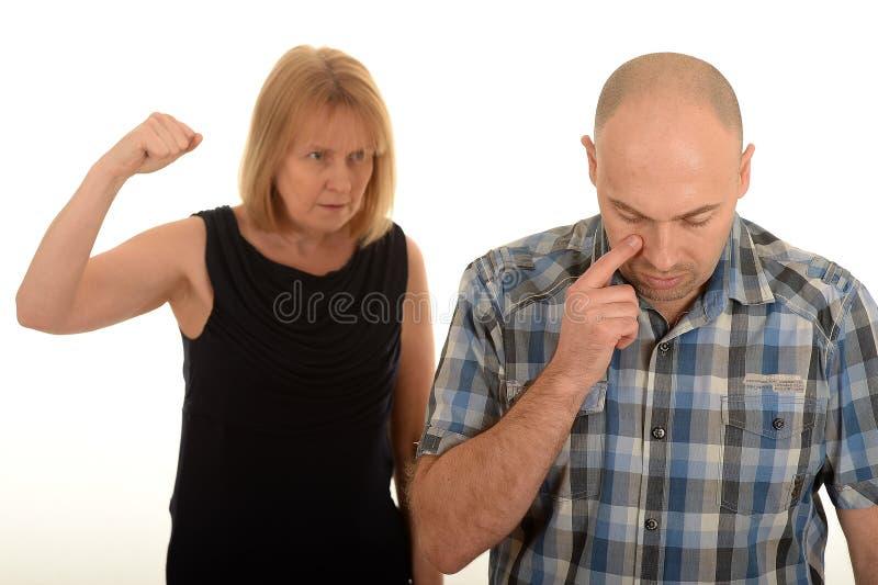 妇女争论与一个人 免版税库存图片